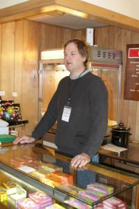 Ian behind candy counter